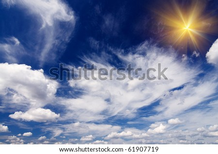 Wonderful blue sky with clouds and fun sun. - stock photo