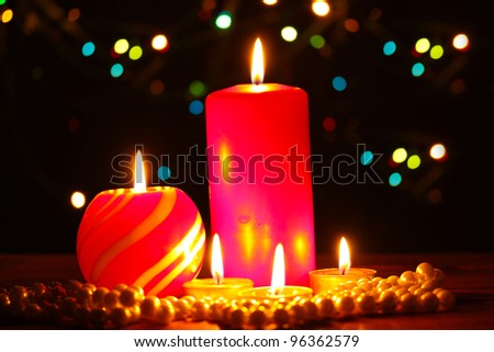 Wonderful candles on wooden table on bright background