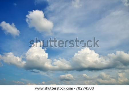 Wonderful clouds against blue sky, sunny spring day - stock photo
