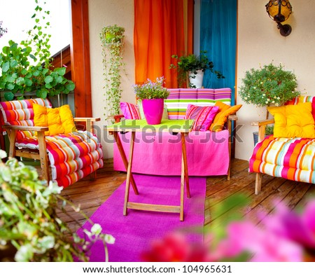 wonderful comfortable balcony with lots of flowers and herbs - stock photo
