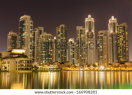 Wonderful Dubai skyscrapers and fountain at night - stock photo