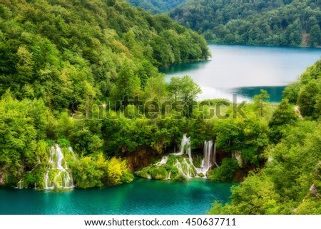 Wonderful emerald lakes and waterfalls, surrounded by forests at Plitvice Lakes National Park, Croatia, nature background suitable for wallpaper or poster - stock photo