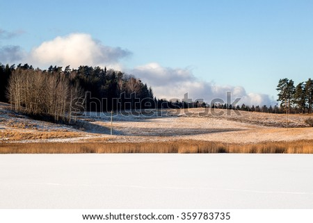 Wonderful flat frozen lake covered with fresh white snow for ice skating - stock photo