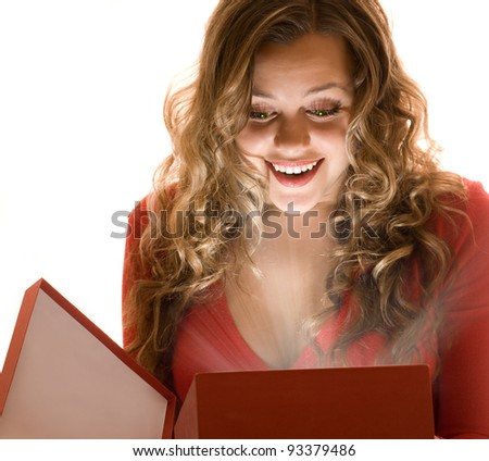 Wonderful gift in the hands of a pretty girl - stock photo