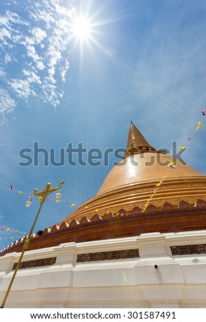 Wonderful gold buddha temple in Thailand with clear sky - stock photo