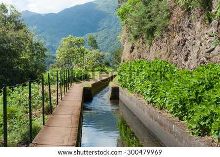 Wonderful hiking trail along levada Ribeira da Janela on Madeira Island, Portugal. - stock photo
