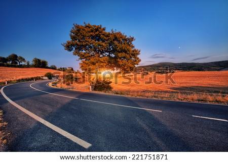 wonderful italy tuscany hill at sunrise or sunset road scenic - stock photo
