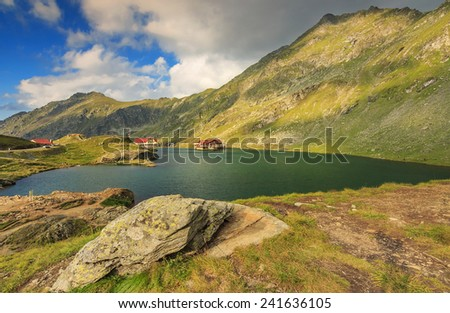 Wonderful mountain lake and cloudy sky,Balea lake,Fagaras mountains,Carpathians,Transylvania,Romania