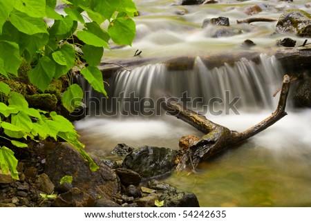 Wonderful mountain stream waterfall. - stock photo