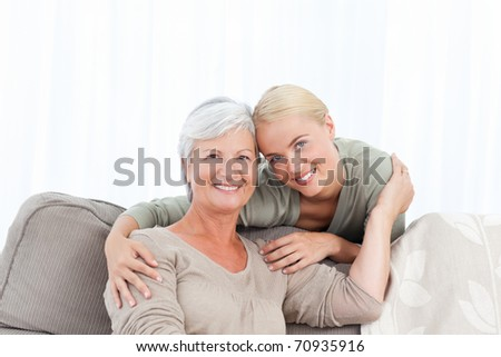 Wonderful nurse and her mature patient looking at the camera