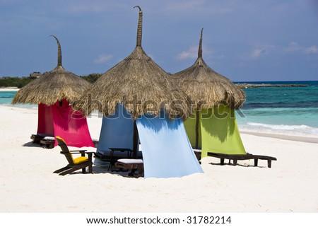 Wonderful palapas on a pristine Caribbean white sand beach. - stock photo
