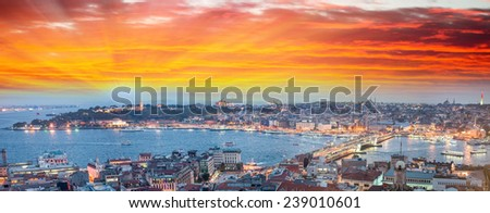 Wonderful panoramic view of Istanbul at dusk across Golden Horn river. - stock photo