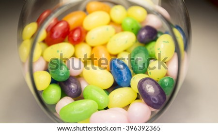 Wonderful photo with delicious colorful jelly beans. Tasty candies. Bright sweet beans in the glass. - stock photo
