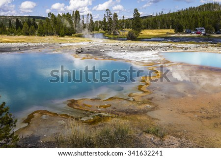 Wonderful pool landscape, Yellowstone with blue pool and golden surface - stock photo
