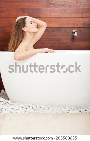 Wonderful pretty woman relaxing during the bath time - stock photo