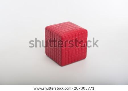Wonderful red padded stool isolated on white background - stock photo