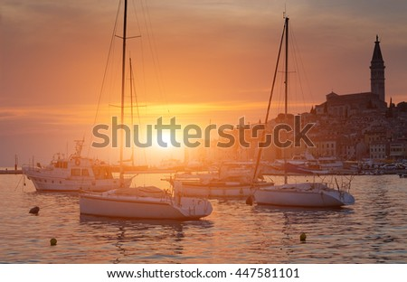 Wonderful romantic old town at Adriatic sea. Boats and yachts in harbour in magical summer sunset. Rovinj. Istria. Croatia. Europe.