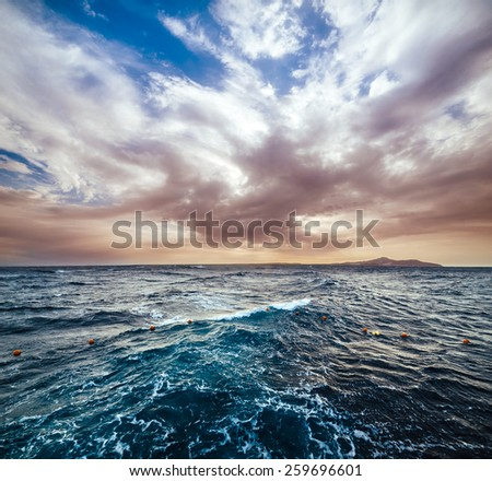 Wonderful solar Red Sea beach at a luxury hotel, at sunset. Sharm El Sheikh, Sinai, Egypt. - stock photo