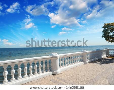 Wonderful stone balcony with great ocean view. - stock photo