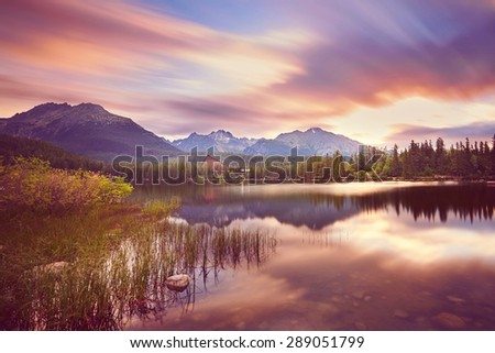 Wonderful sunrise in Strbske pleso in Slovakia. Mountain lake in National Park High Tatras.  - stock photo