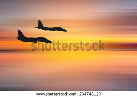 Wonderful sunset over Santa Monica,California with two fighter jets. Abstract piece of art with motion blur - stock photo