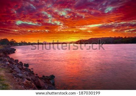 Wonderful sunset over the Tweed River at Chinderah with a Mt. Warning visible on horizon, New South Wales - Australia. HDR - stock photo