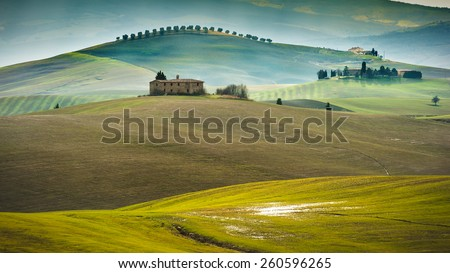 Wonderful sunset over the valley in Tuscany, Italy - stock photo