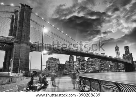Wonderful view of Brooklyn Bridge and Manhattan skyline at sunset from Brooklyn Bridge Park. - stock photo