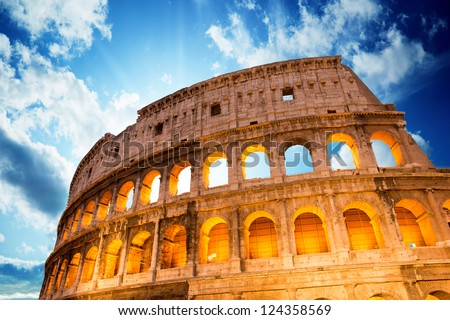 Wonderful view of Colosseum in all its magnificience - Autumn sunset in Rome - Italy - stock photo