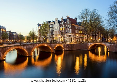 Wonderful view on tradition houses of Amsterdam in night, Netherlands.