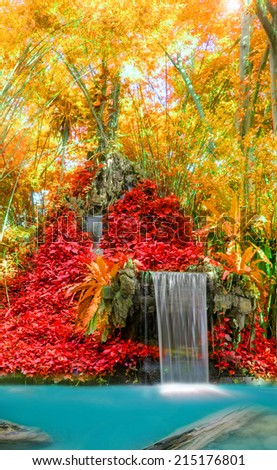 Wonderful Waterfall and red leaf in Deep forest at National Park, Thailand. - stock photo