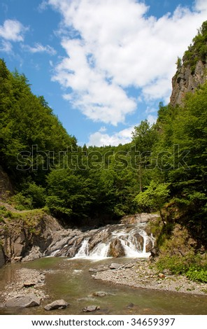 Wonderful waterfall under perfect blue sky - stock photo