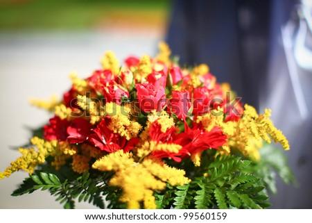 Wonderful wedding bouquet of beautiful colorful summer flowers. - stock photo