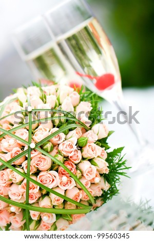 Wonderful wedding luxury bouquet of roses and glasses of champagne. - stock photo