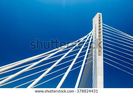 Wonderful white Millennium bridge structure over clear blue sky in Podgorica, Montenegro - stock photo