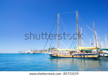 Wonderful yacht in blue bay near Bodrum town. - stock photo