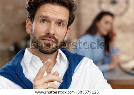 Wondering businessman looking at camera. - stock photo