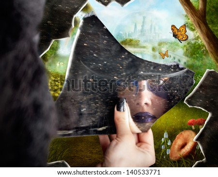 Wonderland jester standing behind broken mirror revealing a magical hidden wonderland of enchanted creatures in fairy tale landscapes - stock photo