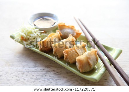 wonton on wood blackground