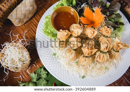 Wonton - Oriental deep fried wontons filled with prawn and spring onion, served with dumpling and chili sauces. - stock photo