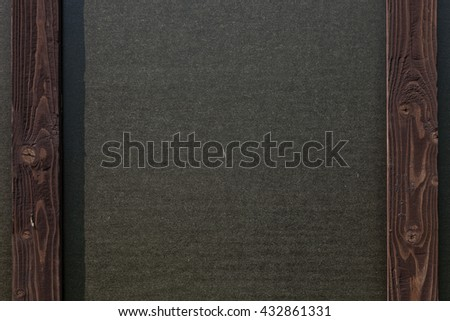 Wood and black paper wall in interior in loft style. Wood plank.Black paper. Wooden frame and black paper. Wood background. Wood table. Black paper and wood.Old wood background. - stock photo