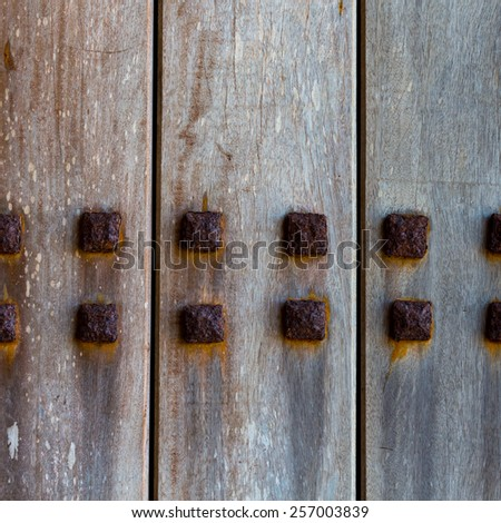 Wood and metal door with metallic spikes looking worn and grungy - stock photo