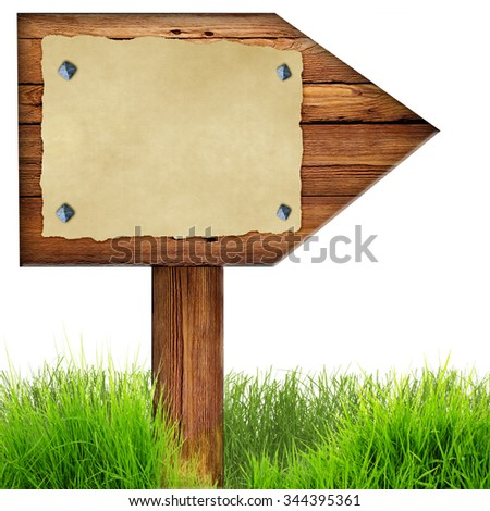Wood arrow sign with old page of paper nailed to planks, green grass around, isolated on a white background. - stock photo