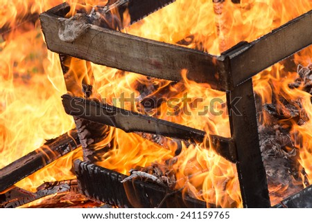 Wood as fuel in the fire. - stock photo