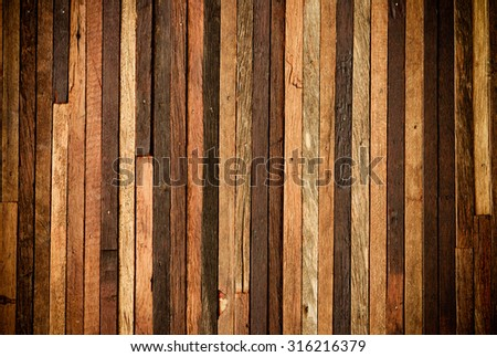 wood background arranged from pieces of hard wood