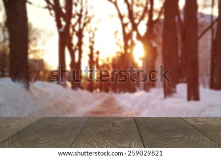 wood background for placing product with winter blurred backdrop - stock photo
