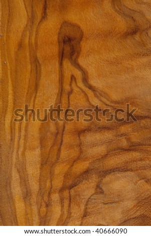 wood background of olive wood with female-like figure