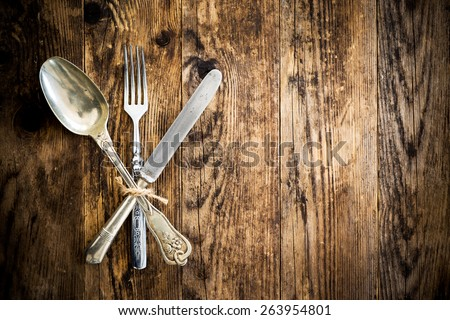 Wood background old cutlery together. - stock photo