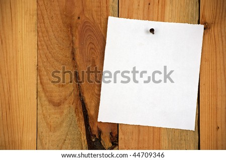 wood background, white note paper