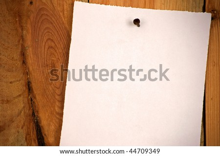 wood background, white note paper, closeup - stock photo
